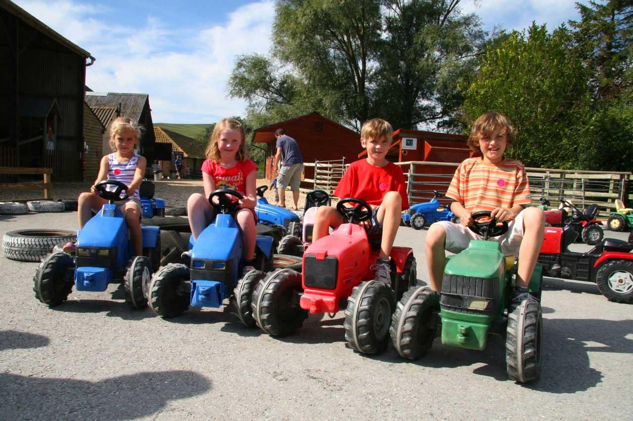 Kids riding tractors